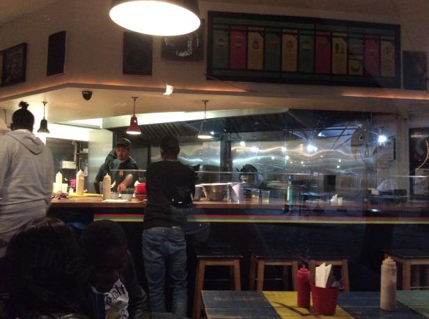 7699490-view_through_window_boom_burger_london_london